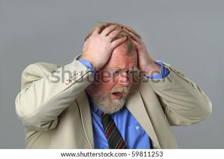 Businessman not satisfied with monthly payment on grey background - stock photo