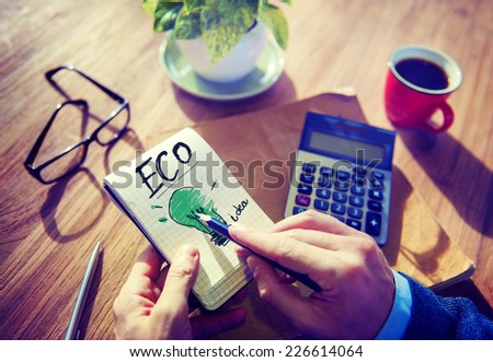 Businessman Notepad Eco Word Concept - stock photo