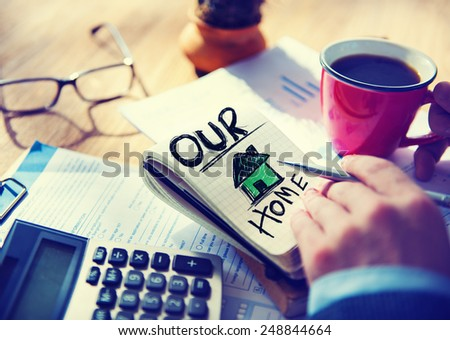 Businessman Notepad Our Home Concept - stock photo