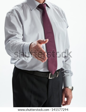 Businessman offering deal (handshake) to you - stock photo