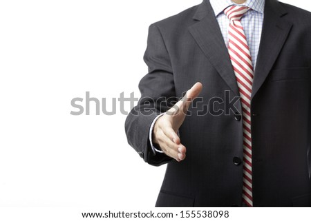 Businessman offering for handshake against white background, Shallow focus, focus on hand. - stock photo