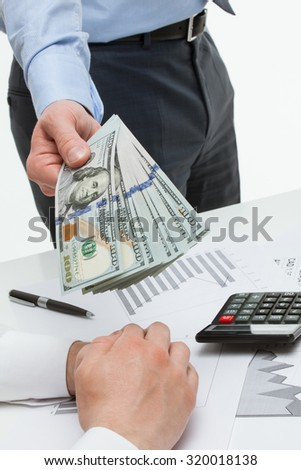 Businessman offering money to business partner, white background