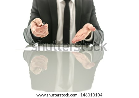 Businessman offering to sign a contract on a white desk. Isolated over white background. - stock photo