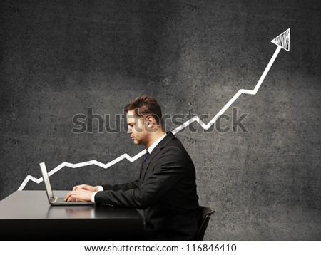 businessman on a background of growth chart