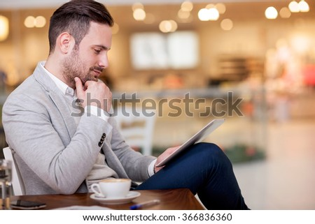 businessman on a break in a cafe thinking about future actions - stock photo