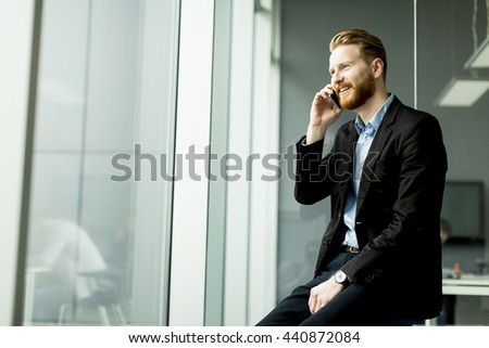 Businessman on a phone in the office - stock photo