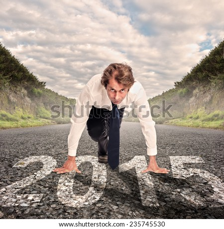 businessman on a road ready to run - stock photo