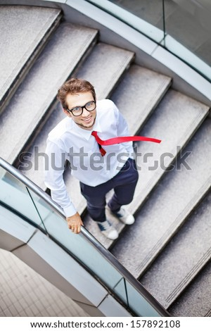 businessman on a stairs - stock photo