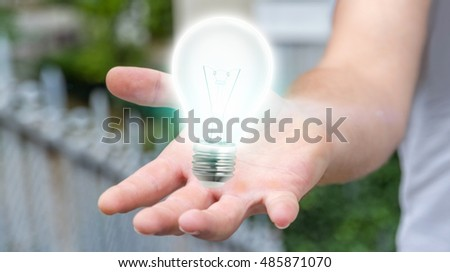 Businessman on blurred background holding shiny lightbulb in his hand 3D rendering