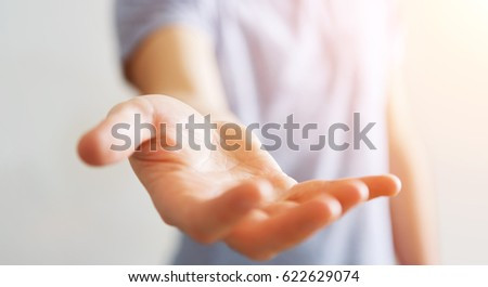 Businessman on blurred background showing his empty hand