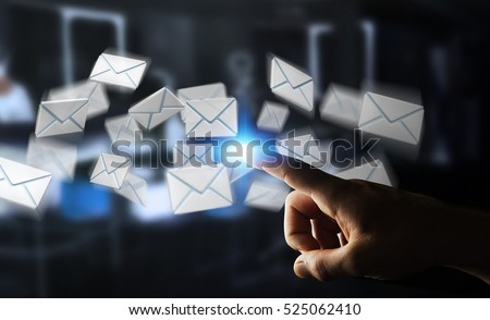 Businessman on blurred background touching 3D rendering flying email icon with his finger