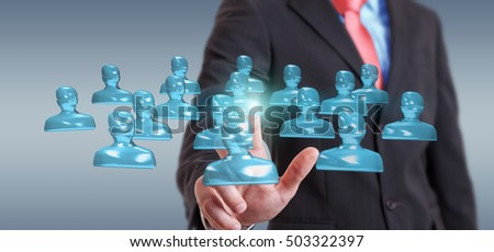Businessman on blurred background touching shiny glass avatar group 3D rendering