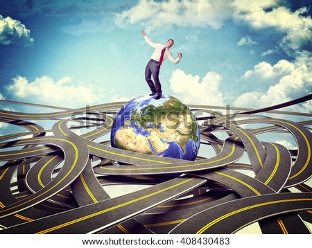businessman on globe and 3d roads