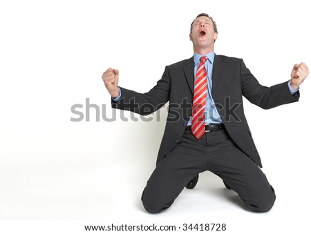 businessman on his knees celebrating