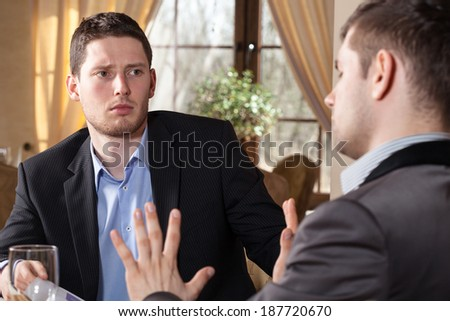 Businessman on meeting in restaurant discussing about project - stock photo