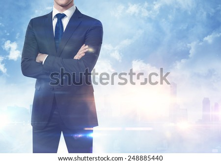 Businessman on megalopolis background - stock photo