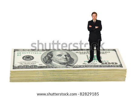 Businessman on money isolated on white background - stock photo