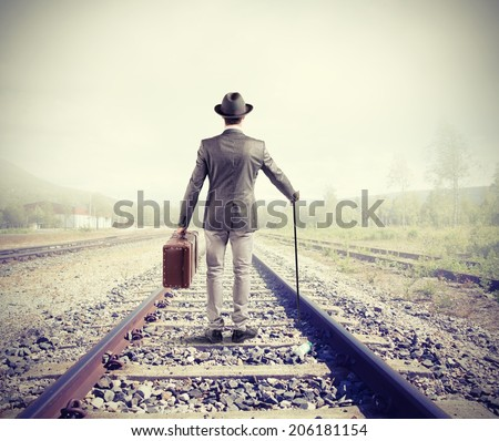 Businessman on railway walking for new business opportunity - stock photo