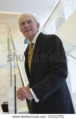 Businessman on staircase.