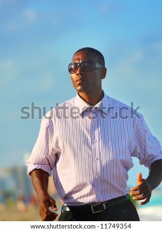 Businessman on the beach - stock photo