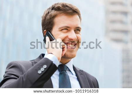 Businessman on the phon outdoor