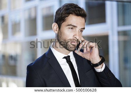 Businessman on the phone, looking away