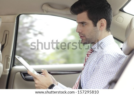 Businessman on the road working while traveling - stock photo