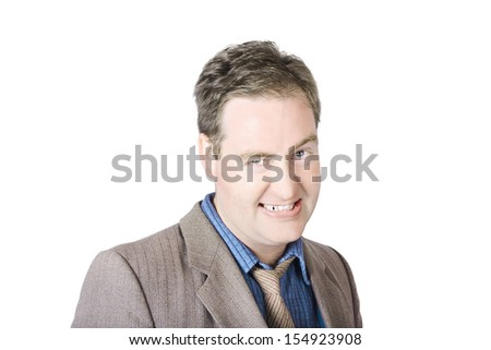 Businessman On White Background Clenching His Teeth