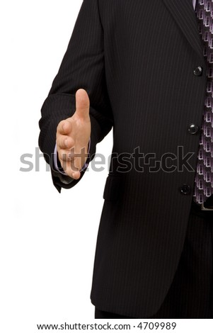 Businessman on white holding hand out for handshake - stock photo