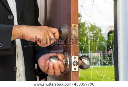businessman open the door by key found the net for tap concept - can use to display or montage on product or concept of business decision - stock photo