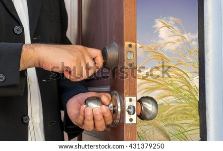 businessman open the door by key to new road view and warm filter - can use to display or montage on product - stock photo