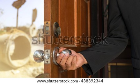 businessman open the door to road construction site - can use to display or montage on product or concept construction for develop city - stock photo