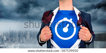 Businessman opening his shirt superhero style against coastline and city - stock photo