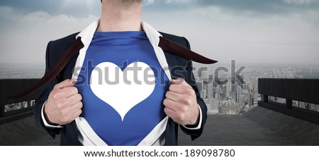 Businessman opening his shirt superhero style against road leading to city - stock photo