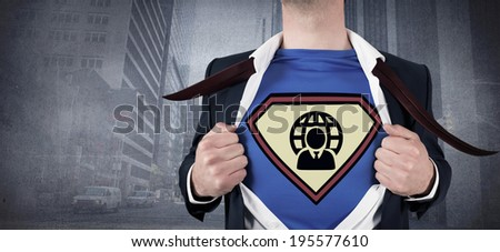 Businessman opening shirt in superhero style against urban projection on wall
