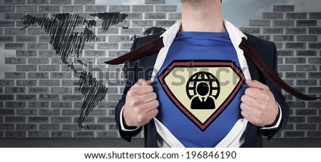 Businessman opening shirt in superhero style against world map doodle against wall