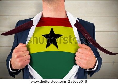 Businessman opening shirt to reveal ghana flag against bleached wooden planks background - stock photo