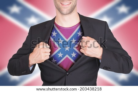 Businessman opening suit to reveal shirt with flag, confederacy - stock photo