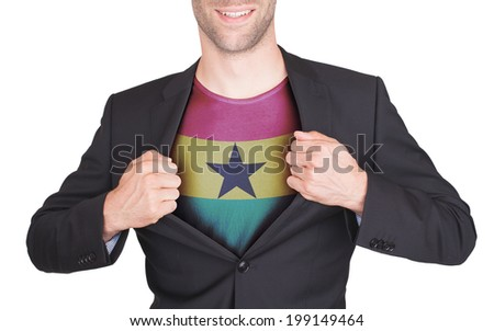 Businessman opening suit to reveal shirt with flag, Ghana - stock photo