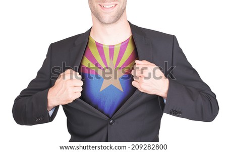 Businessman opening suit to reveal shirt with state flag (USA), Arizona - stock photo