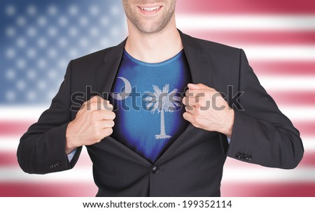 Businessman opening suit to reveal shirt with state flag (USA), South Carolina - stock photo