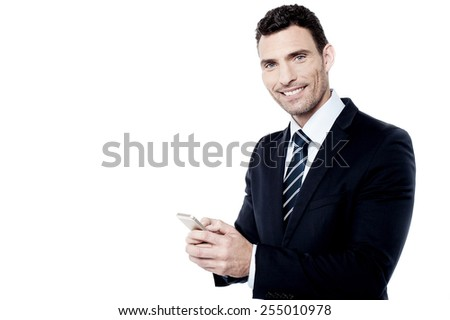 Businessman operating his mobile phone - stock photo