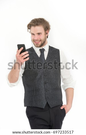 Businessman or ceo listen music. Man in formal outfit with mobile phone. Manager with beard on smiling face. Headset and mp3. Fashion and new technology.
