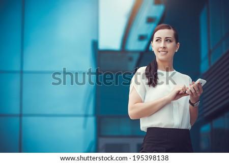 businessman or entrepreneur talking on cellphone. City businesswoman working. - stock photo
