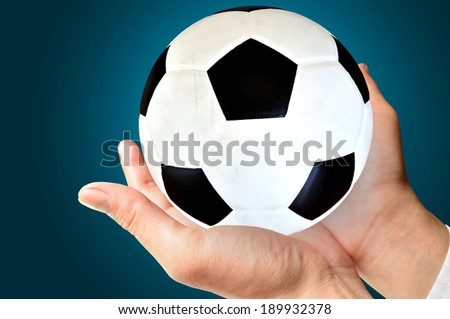 businessman or Manager holding a soccer ball, close up  - stock photo