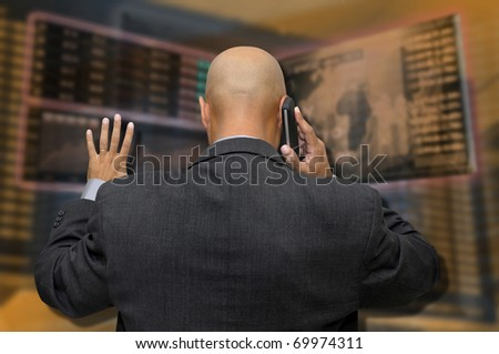 Businessman or stock broker at the phone in stock exchange