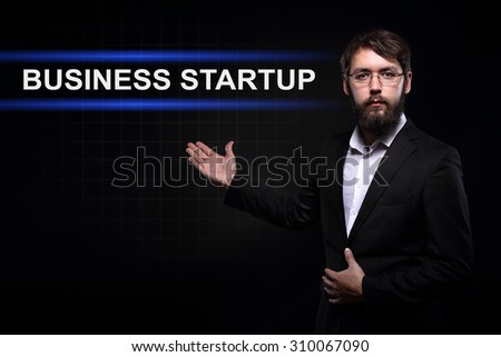 Businessman over black background presenting Business startup - stock photo