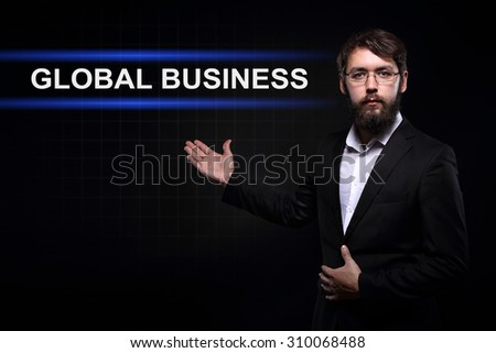 Businessman over black background presenting Global business - stock photo