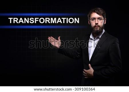 Businessman over black background presenting transformation  - stock photo