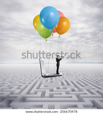 Businessman overcomes the obstacle with a flying laptop - stock photo